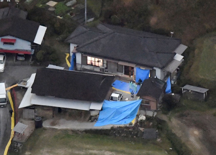 An aerial photo taken Nov. 26 shows a house in Miyazaki Prefecture where six bodies were discovered earlier in the day.