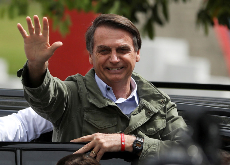 Jair Bolsonaro, far-right lawmaker and then-presidential candidate of the Social Liberal Party (PSL), gestures at a polling station in Rio de Janeiro on Oct. 28.