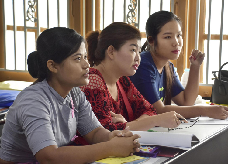 Myanmar women planning to go to Japan as foreign trainees to work as caregivers study Japanese at a school in Yangon in May.