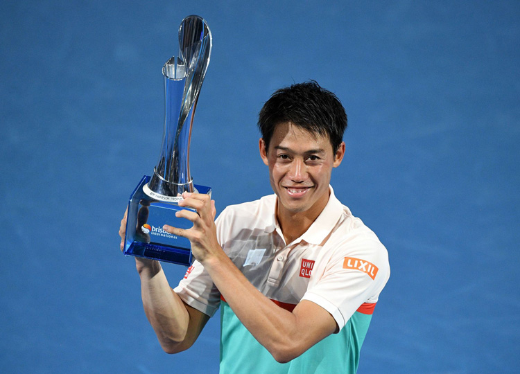 Kei Nishikori celebrates with the winner's trophy after defeating Daniil Medvedev of Russia in the men's singles final at the Brisbane International on Jan. 6.