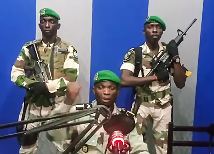 """In this video grab made on a video footage obtained on YouTube on Jan. 7, Gabon soldiers on state radio called on the people to """"rise up."""""""