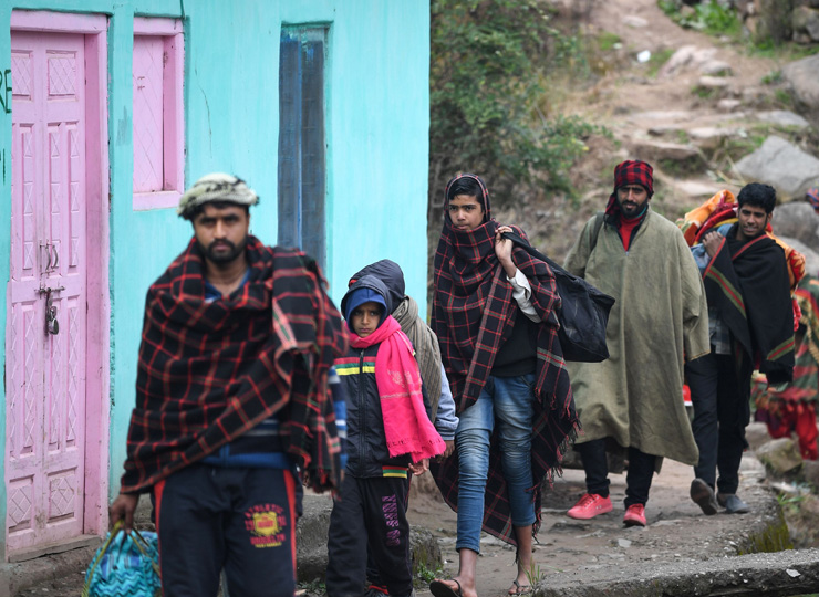 Refugees - some of the hundreds fleeing their homes in Chhajla village in India's Mendhar disctrict, near the Line of Control with Pakistan ? arrive at a community relief camp on March 1.