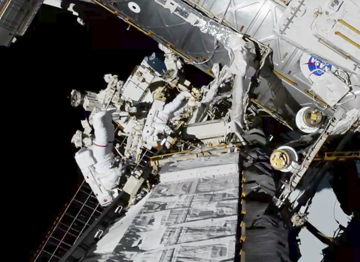 Astronauts Christina Koch and Jessica Meir exit the International Space Station on Oct. 18.