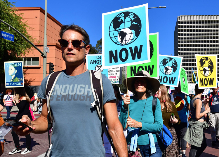 Activists march through downtown Los Angeles in a climate change rally on Nov. 1.