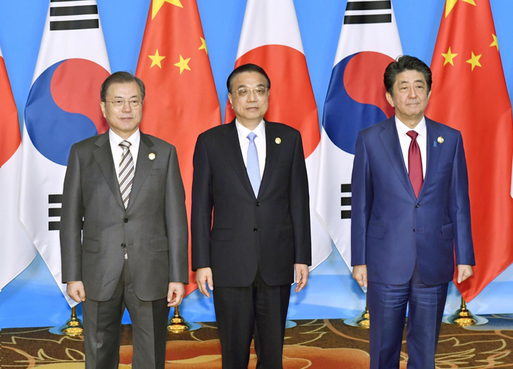 (From left) South Korean President Moon Jae-in, Chinese Premier Li Keqiang and Prime Minister Shinzo Abe pose before their meeting in Chengdu, China, on Dec. 24.