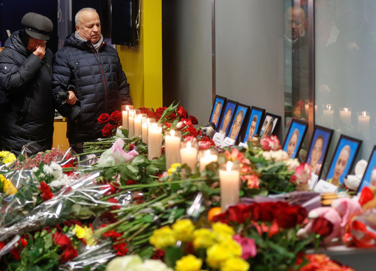 Relatives of the flight crew of the Ukraine International Airlines Boeing 737-800 plane mourn at a memorial at Boryspil International Airport outside Kiev on Jan. 11.