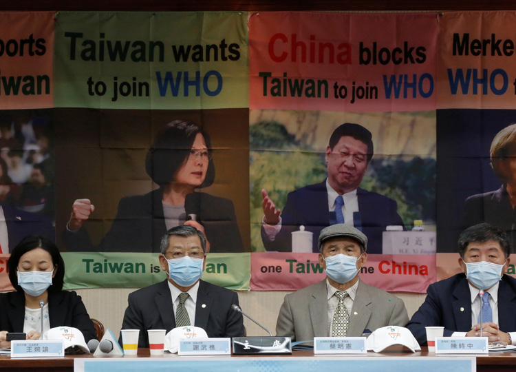 Taiwan Health Minister Chen Shih-chung (right), parliament members and activists hold a news conference about Taiwan's efforts to get into the World Health Assembly in Taipei on May 15.