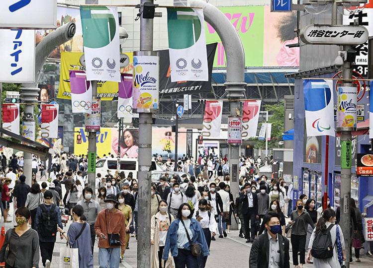 People walk in Tokyo's Shibuya district on May 28.