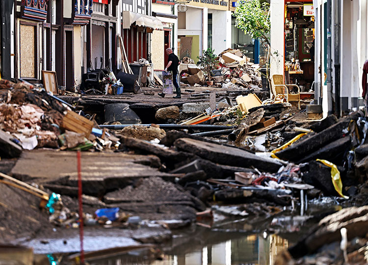 A man moves debris in Bad Muenstereifel, western Germany, on July 18.