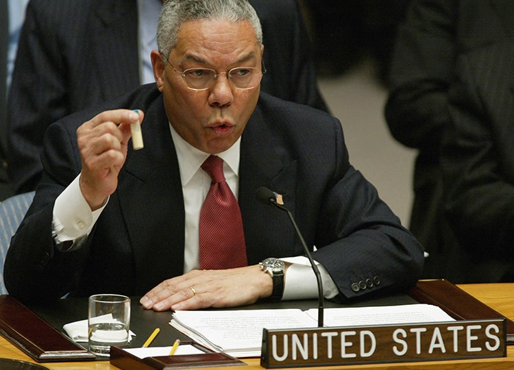 In this file photo taken on Feb. 5, 2003, U.S. Secretary of State Colin Powell holds up a vial that he said was the size that could be used to hold anthrax at the U.N. in New York.