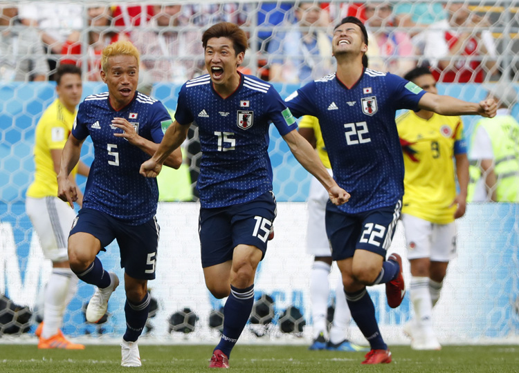 Japan's Yuya Osako (center) celebrates with teammates after scoring the go-ahead goal in the second half against Colombia in their Group H match in Saransk, Russia, on June 19.