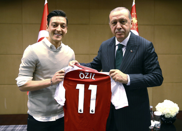 Turkey's President Recep Tayyip Erdo?an (right) poses for a photo with Mesut Ozil in London on May 13 holding Ozil's Arsenal shirt.