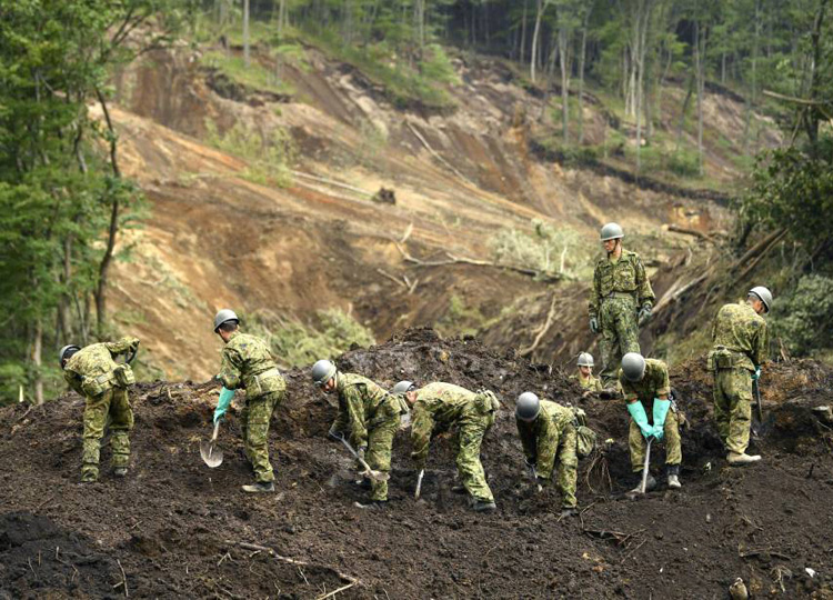 Self-Defense Forces personnel work at the site of a landslide in Atsuma, Hokkaido, on Sept. 9 after the magnitude 6.7 earthquake struck Sept. 6.