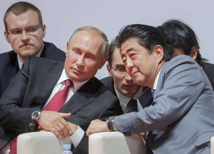 Russian President Vladimir Putin and Prime Minister Shinzo Abe attend an international judo tournament on the sidelines of the Eastern Economic Forum in Vladivostok, Russia, on Sept. 12.