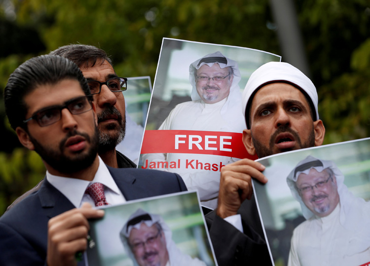 Human rights activists and friends of Saudi journalist Jamal Khashoggi hold pictures of him during a protest outside the Saudi Consulate in Istanbul on Oct. 8.