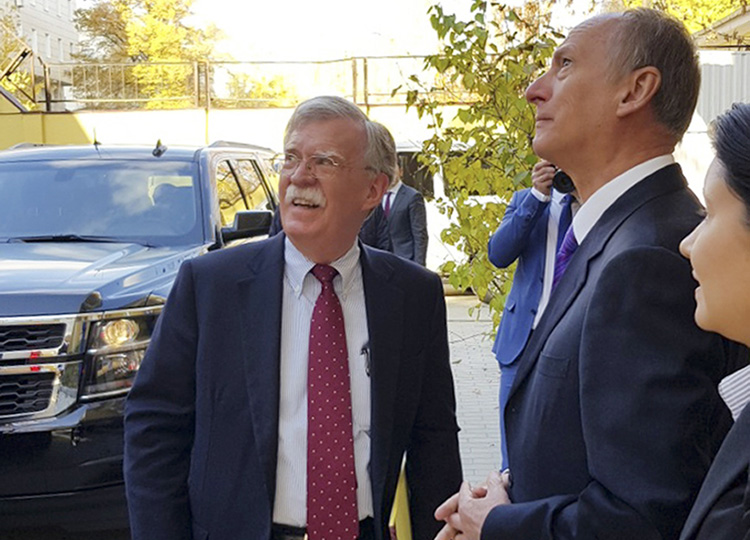 U.S. national security adviser John Bolton (left) and Nikolai Patrushev, the secretary of the Russian Security Council, in Moscow on Oct. 22