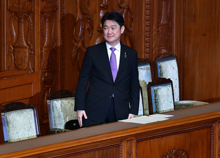 Justice Minister Takashi Yamashita attends a plenary session of the Upper House on Dec. 7.