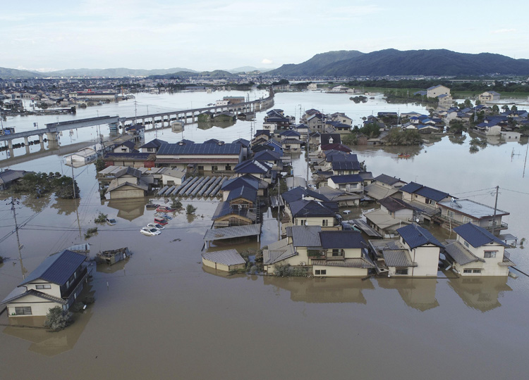 An aerial photo shows the Mabicho district in Kurashiki, Okayama Prefecture, buried in water on July 8.