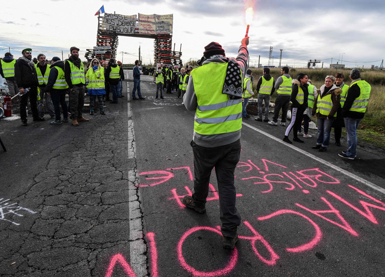 """""""Yellow vest"""" protesters block the road leading to the Frontignan oil depot in the south of France, as they demonstrate against the rise in fuel prices and the cost of living on Dec. 3."""
