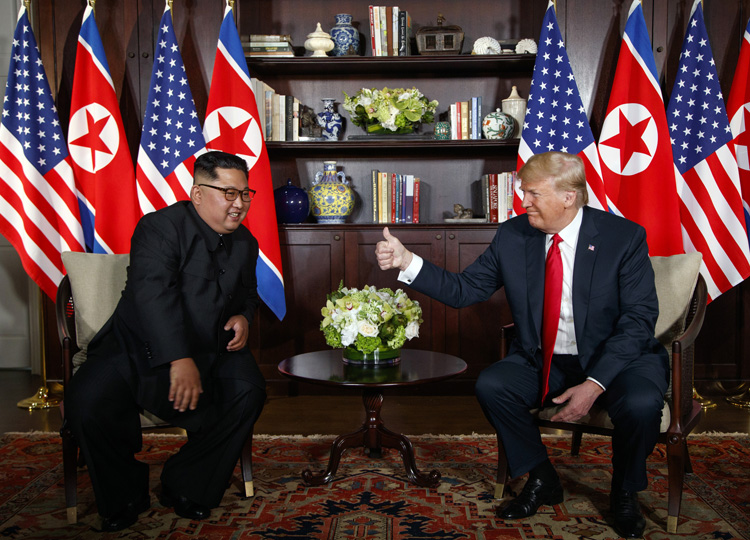 U.S. President Donald Trump (right) meets with North Korean leader Kim Jong Un on Sentosa Island in Singapore on June 12.