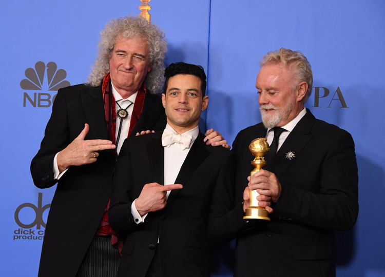 Rami Malek (center), best actor in a drama for Bohemian Rhapsody, poses with Queen band members Brian May (left) and Roger Taylor during the 76th annual Golden Globe Awards on Jan. 6 at the Beverly Hilton hotel in Beverly Hills, California.