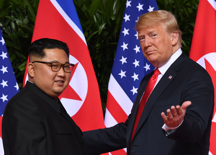 In this file photo taken on June 12, 2018, U.S. President Donald Trump (right) meets with North Korea's leader Kim Jong Un at the start of their U.S.-North Korea summit, at the Capella Hotel on Sentosa Island in Singapore.
