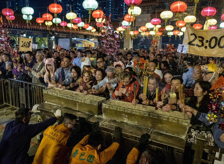 Worshippers burn incense and pray at the Wong Tai Sin Temple to welcome in the Lunar New Year of the Pig in Hong Kong late on Feb. 4.