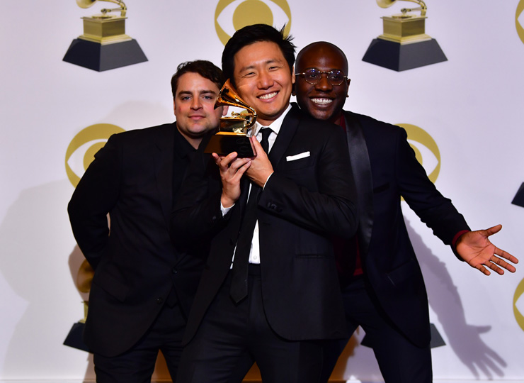 Hiro Murai (center), director of Childish Gambino's music video This is America, poses with video producers Jason Cole (left) and Ibra Ake with their award for best music video during the 61st Annual Grammy Awards on Feb. 10 in Los Angeles.