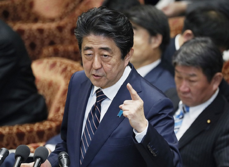 Prime Minister Shinzo Abe speaks at a Lower House session on Feb. 18.KYODO