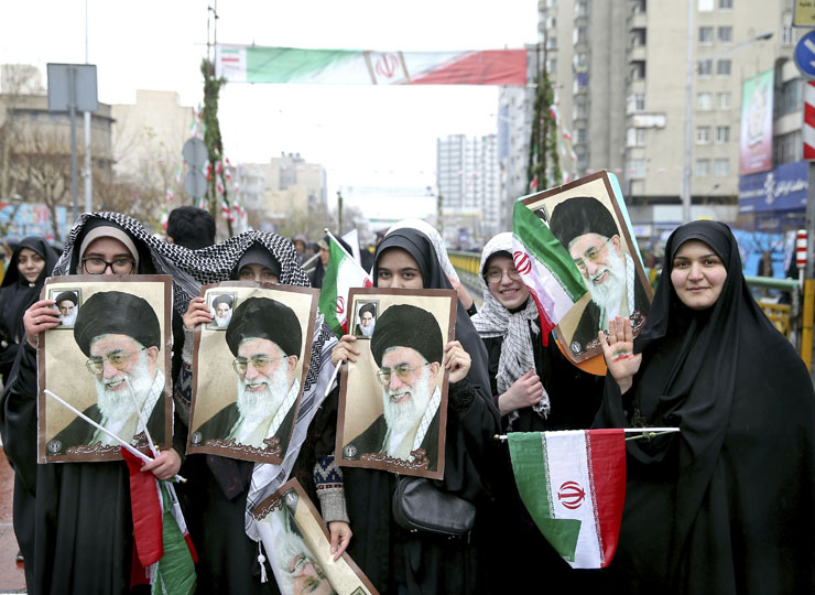 Iranian women hold up portraits of Iranian Supreme Leader Ayatollah Ali Khamenei during a rally marking the 40th anniversary of the 1979 Islamic Revolution, in Tehran, on Feb. 11.