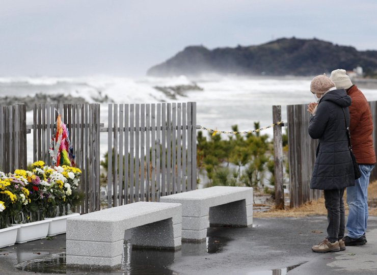 A couple pray by the sea in the city of Iwaki, Fukushima Prefecture, on March 11, the eighth anniversary of the 2011 triple disaster.