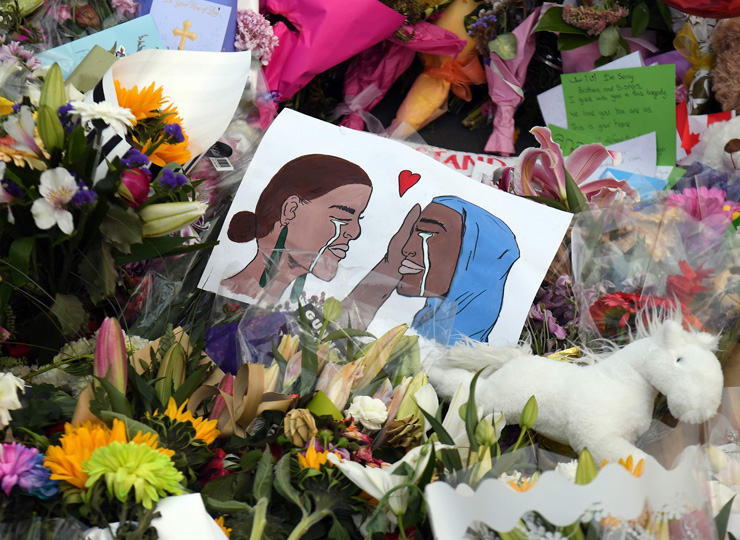 A poster is seen at a memorial site for the victims of mosque attacks in Christchurch, New Zealand, on March 19.