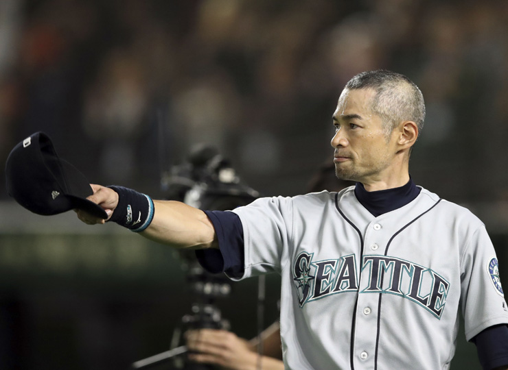 Seattle Mariners right fielder Ichiro Suzuki tips his cap after being removed from the game during the eighth inning against the Oakland Athletics at Tokyo Dome on March 21.