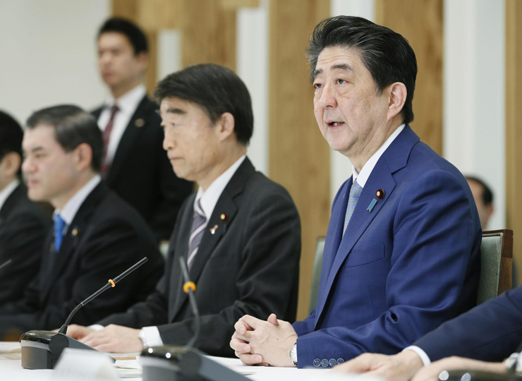 Prime Minister Shinzo Abe speaks at a meeting of Cabinet ministers on the revision of the child abuse prevention law and associated measures at his office in Tokyo on March 19.