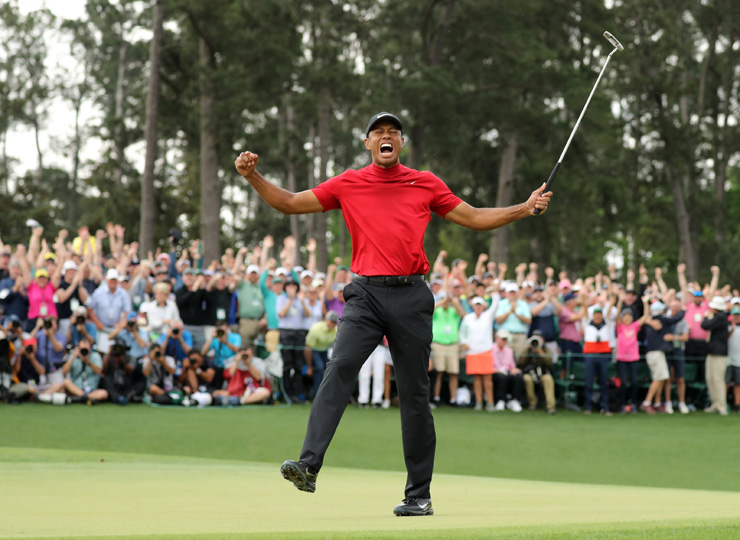 Tiger Woods celebrates April 14 on the 18th hole after winning the 2019 Masters in Augusta, Georgia.