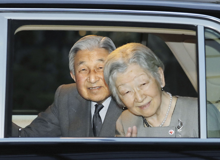 Emperor Akihito and Empress Michiko are seen leaving the Japan Red Cross building in Minato Ward, Tokyo, after visiting a photo exhibition on March 29.