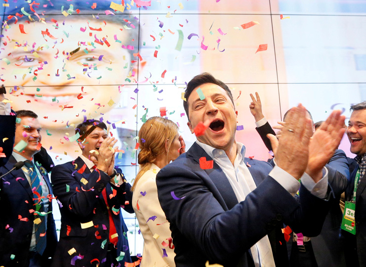 Volodymyr Zelenskiy reacts following the announcement of the first exit poll in the Ukrainian presidential election runoff at his campaign headquarters in Kiev on April 21.
