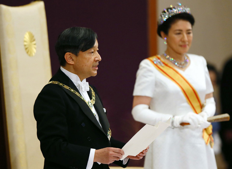 Emperor Naruhito delivers his speech beside Empress Masako during a ceremony to receive his first audience after he acceded to the throne at the Matsu-no-Ma state room inside the Imperial Palace in Tokyo on May 1.