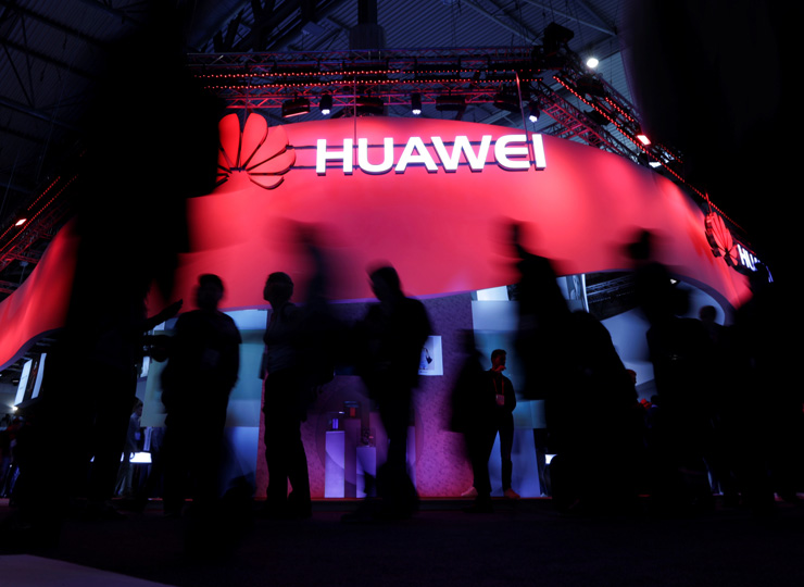 Visitors walk past Huawei's booth during the Mobile World Congress in Barcelona, Spain, in this 2017 file photo.