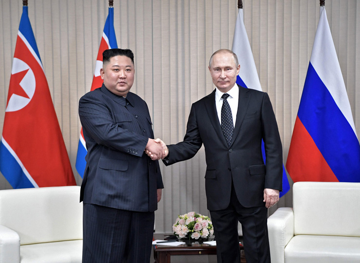 Russian President Vladimir Putin (right) meets with North Korean leader Kim Jong Un at the Far Eastern Federal University campus on Russky Island off Vladivostok on April 25.