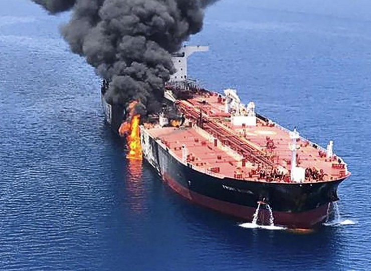 An oil tanker is on fire in the Gulf of Oman on June 13. Two oil tankers near the strategic Strait of Hormuz were reportedly attacked the same day, an assault that left one ablaze as sailors were evacuated from both vessels.