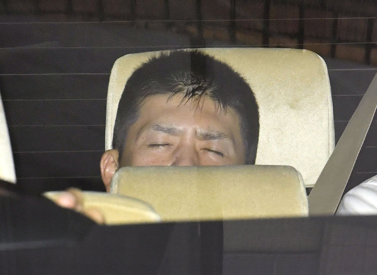 Makoto Kobayashi is taken from the Yokohama District Public Prosecutor's Office on June 23 after his arrest earlier in the day. It took four days for police to catch the fugitive after he escaped an attempt to take him into custody.