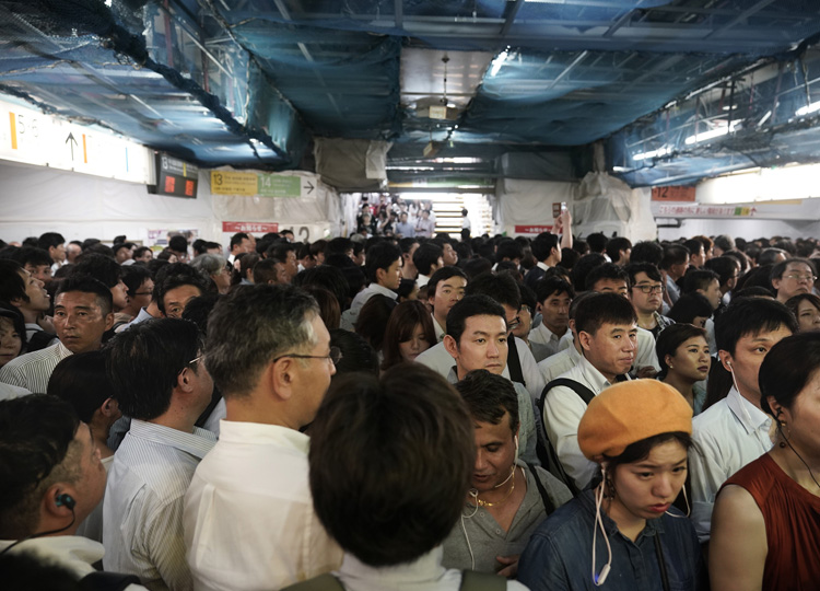 Commuters wait for train platforms to open at Shinjuku Station on Sept. 9 in Tokyo.