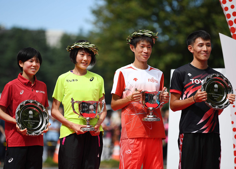 (From left) Ayuko Suzuki, Honami Maeda, Shogo Nakamura and Yuma Hattori pose on the podium with their trophies following the Marathon Grand Championship, the marathon test event for next year's Olympic Games, in Tokyo on Sept. 15.