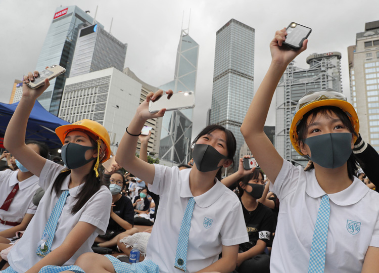 Students wear protective gear during a protest in Hong Kong on Sept. 2.