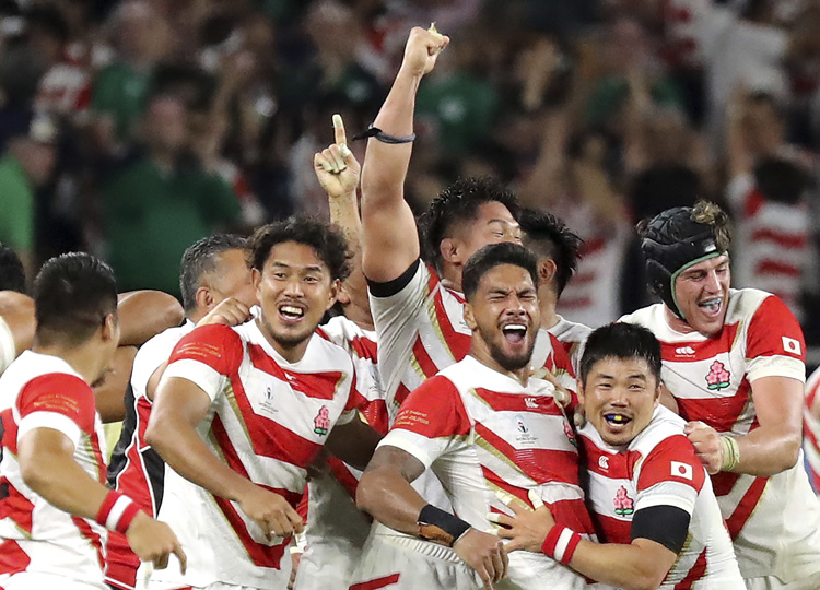 Japan's Brave Blossoms celebrate after beating Ireland in Shizuoka in their second Pool A game of the 2019 Rugby World Cup on Sept. 28.