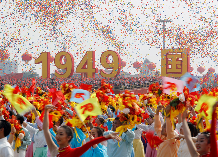 Balloons are seen above performers at the end of the parade marking the 70th anniversary of the People's Republic of China, on its National Day in Beijing on Oct 1.