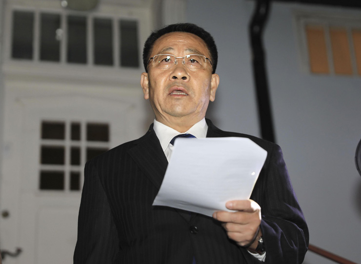 North Korean negotiator Kim Miyong Gil speaks outside the North Korean Embassy in Stockholm on Oct. 5.