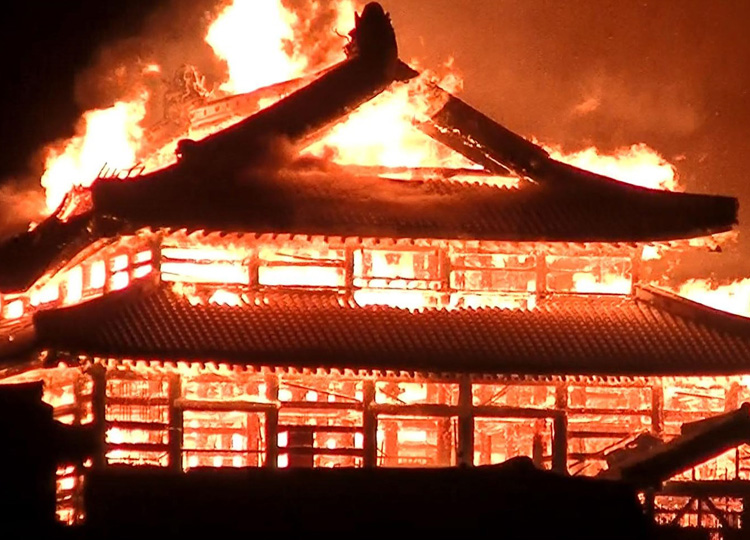 A picture taken by a resident in Naha, Okinawa Prefecture, shows the main building of Shuri Castle engulfed in flames early Oct. 31.