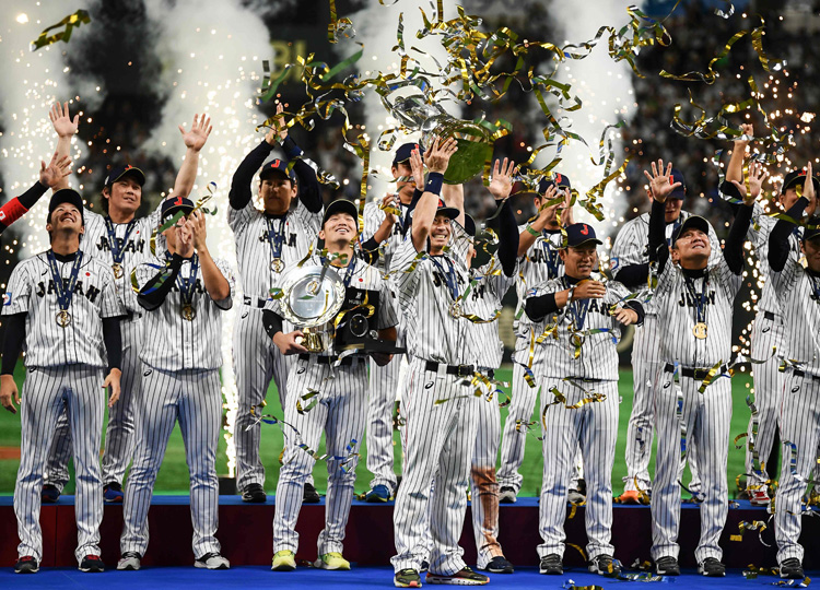 Japan's baseball players celebrate after the WBSC Premier12 Super Round Final baseball game against South Korea at Tokyo Dome on Nov. 17.